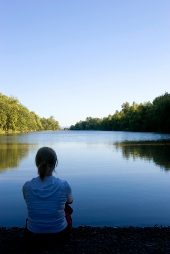 woman meditating at lake small